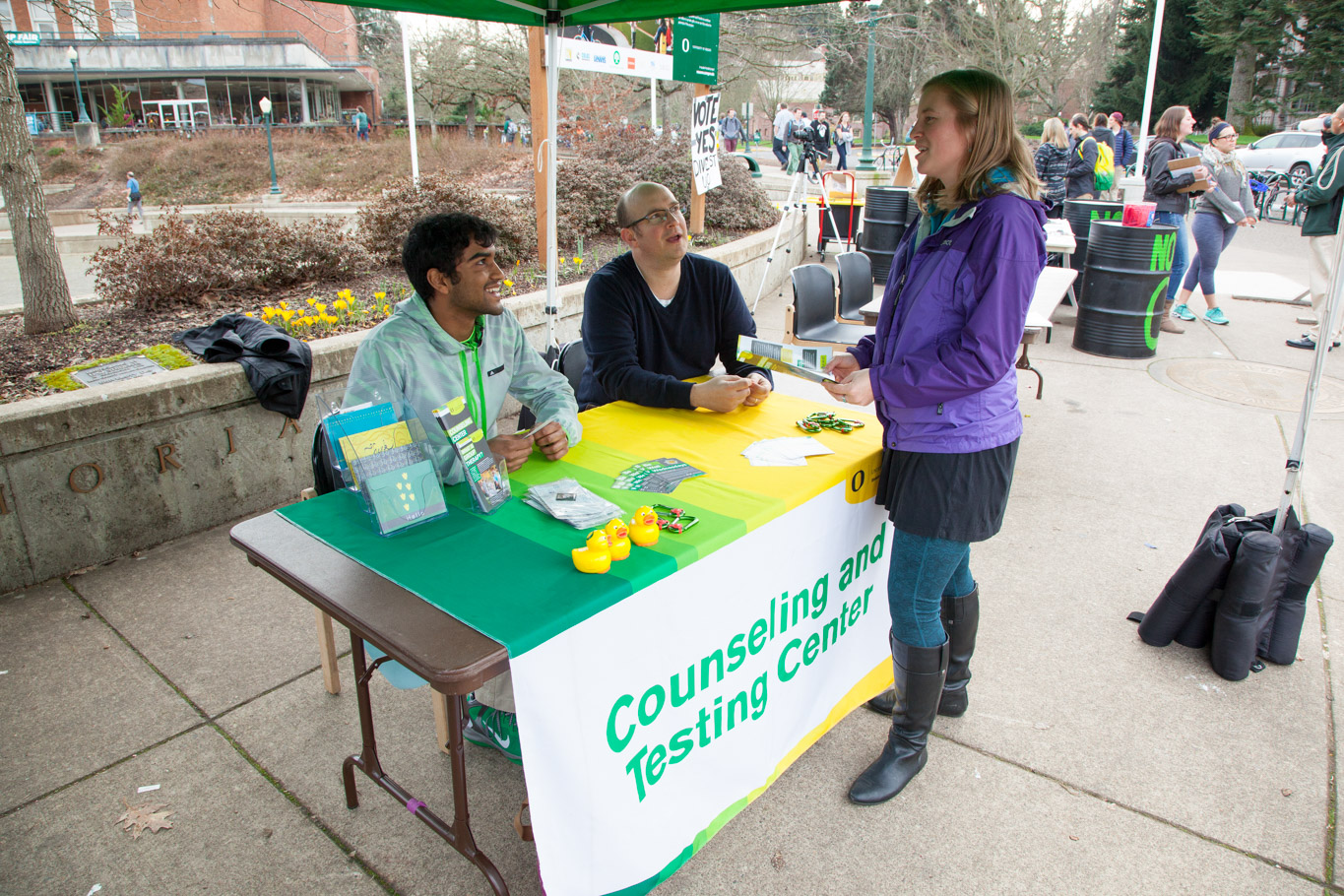 Counseling center staff table in front of the Erb Memorial Union