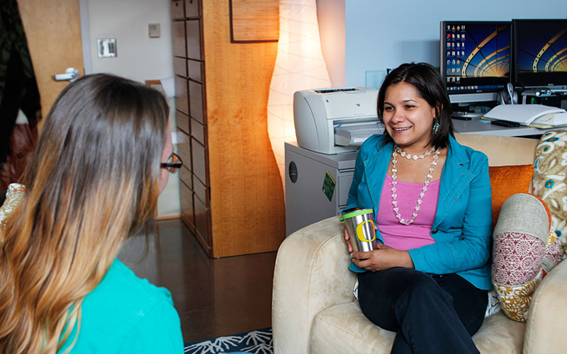 A student meeting with a counselor.